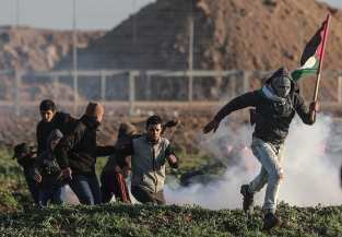 "Israeli forces intervene in Palestinians with tear gas during a protest within ""Great March of Return"" demonstrations in Shuja'iyya neighborhood of Gaza City, Gaza on January 18, 2019. ( Ali Jadallah - Anadolu Agency )"